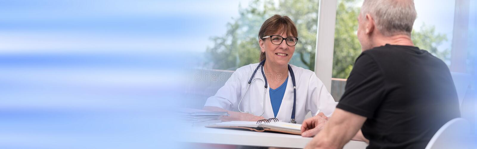 Female doctor talking with her patient royalty free stock photos