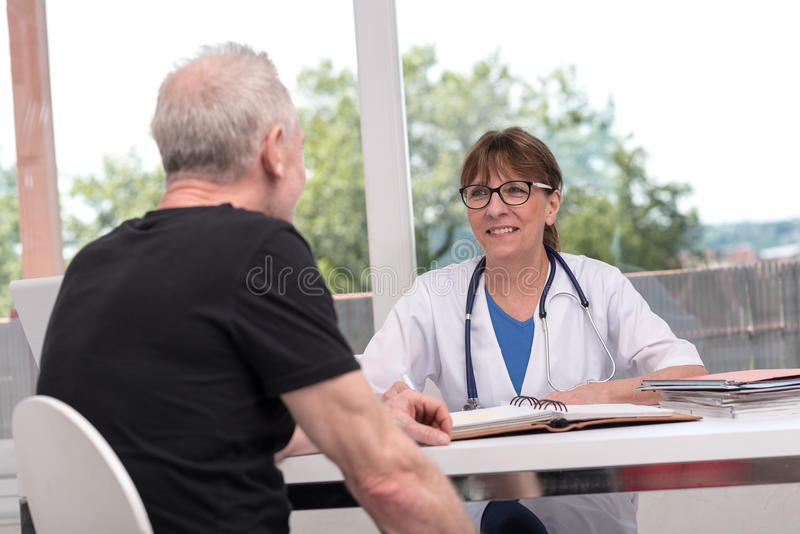 Female doctor talking with her patient stock photography