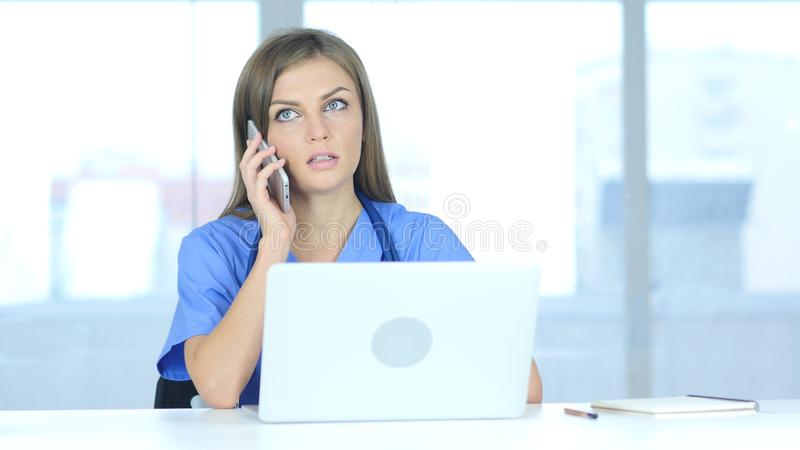 Female Doctor Talking on Phone in Laboratory. 4k , high quality royalty free stock photos