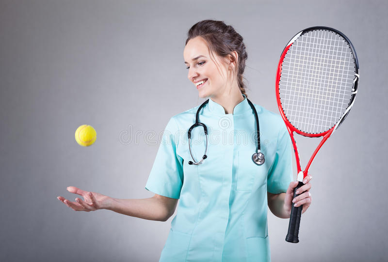 Female doctor with a tennis racket royalty free stock images