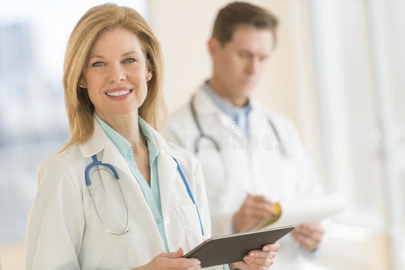 Female Doctor Using Digital Tablet At Hospital royalty free stock photo
