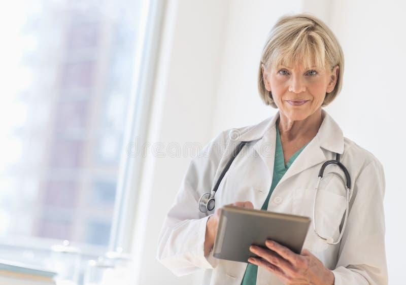 Female Doctor Using Digital Tablet In Hospital stock images