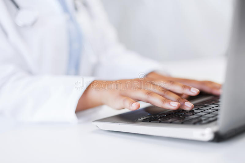Download Female Doctor Using Her Laptop Computer Royalty Free Stock Photography - Image: 35229177