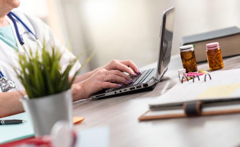 Female doctor using laptop royalty free stock image
