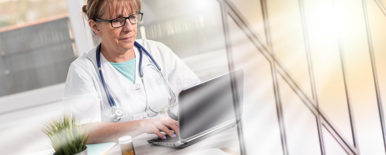 Female doctor using laptop; multiple exposure royalty free stock photos