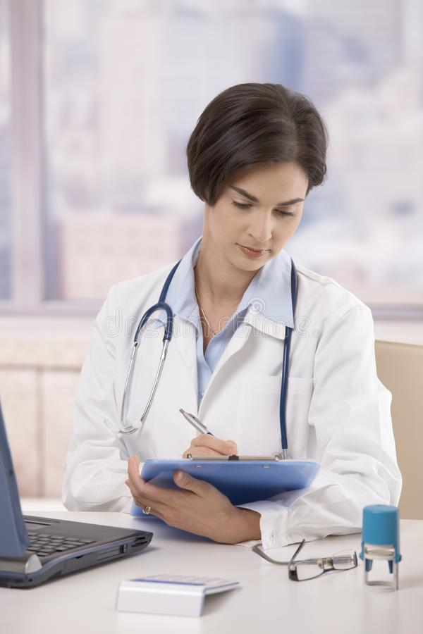Female doctor working in office royalty free stock photos