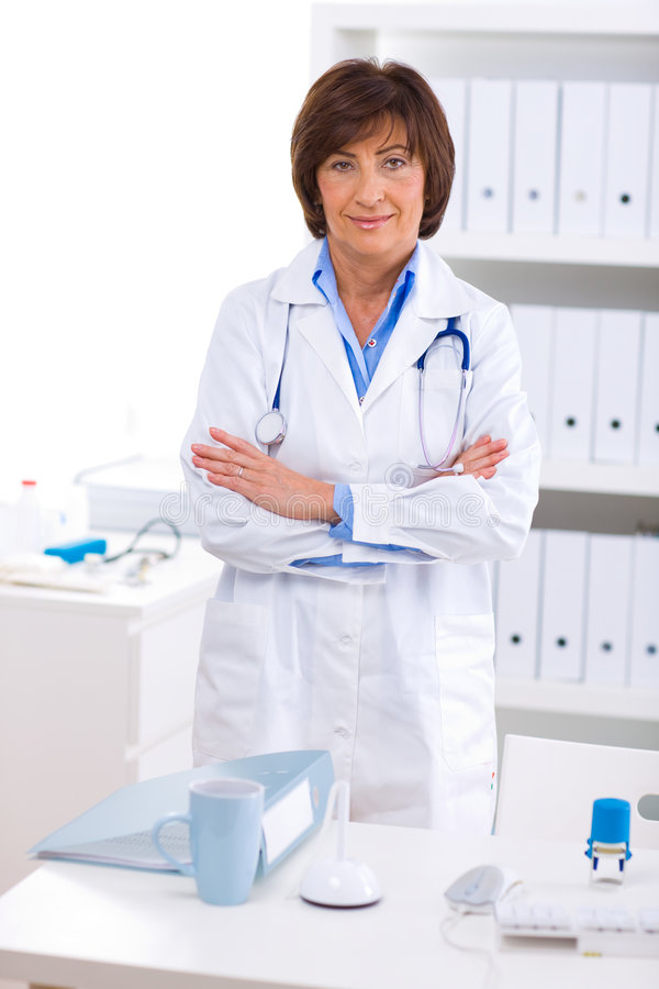 Female doctor working at office royalty free stock image
