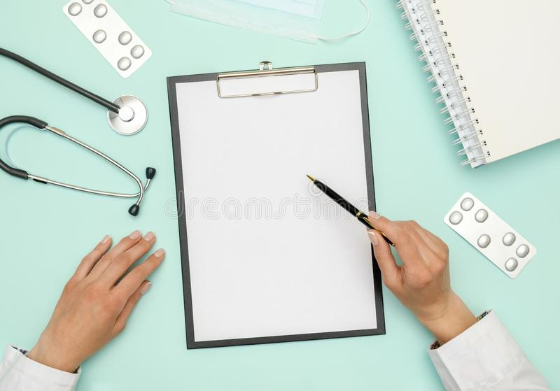 Female doctor working at workplace with laptop royalty free stock images