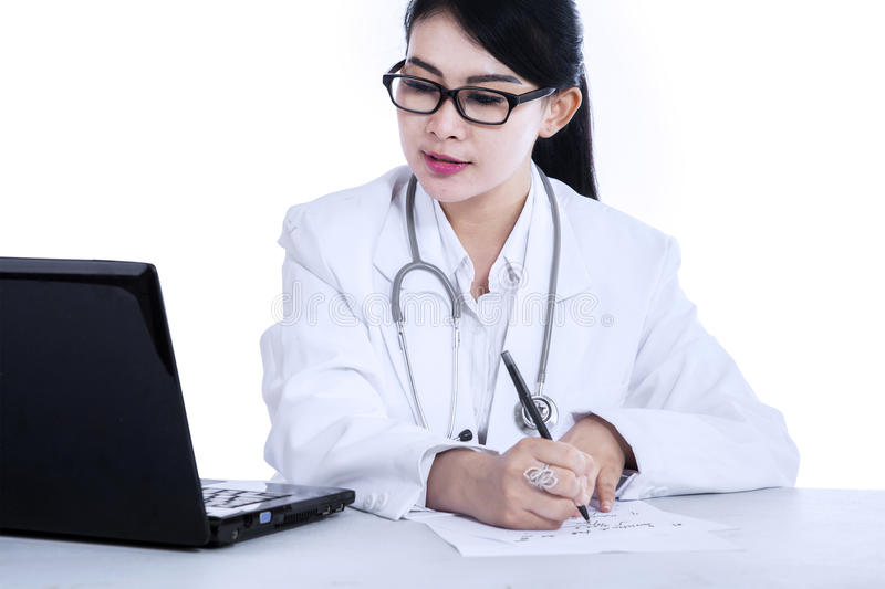 Female doctor writes medical reports royalty free stock photos