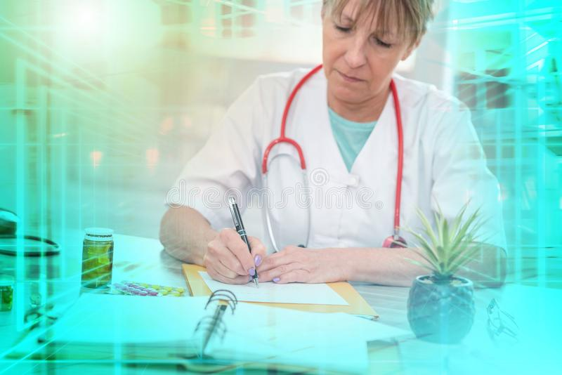 Female doctor writing a medical prescription; multiple exposure royalty free stock photos
