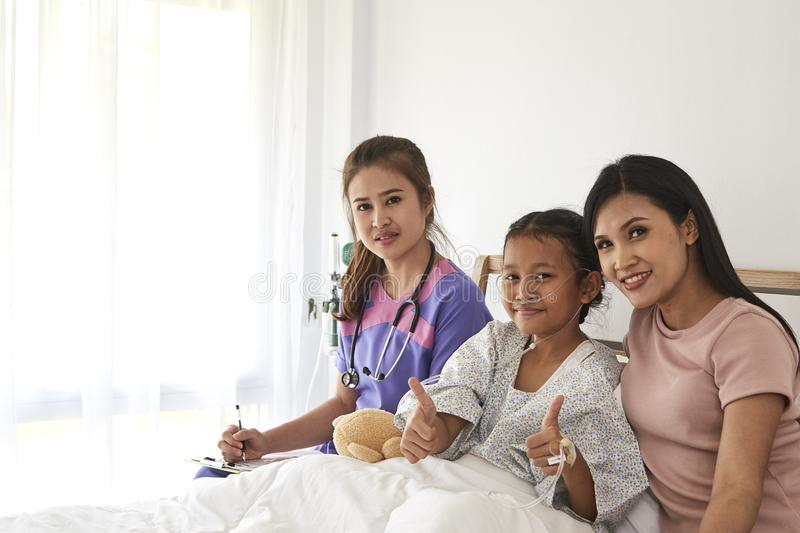 Doctor and child with mother in hospital royalty free stock photos