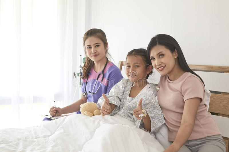 Doctor and child with mother in hospital stock images