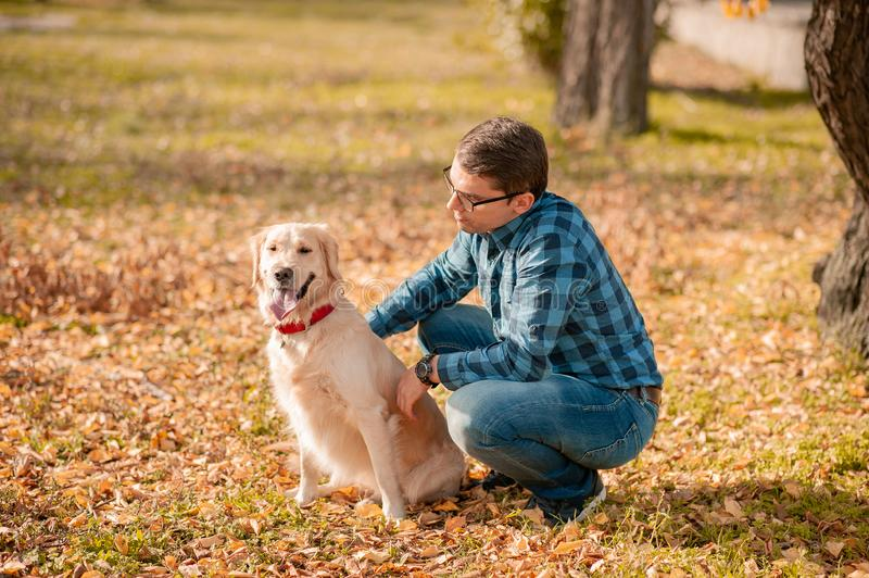 Female with dog golden retriever having fun on autumn vacation royalty free stock image