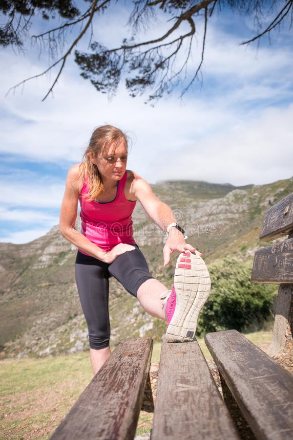 Female doing a hamstring stretch stock photos