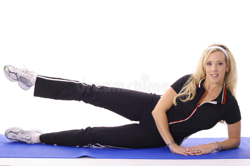 Female Doing Leg Lifts Stock Image