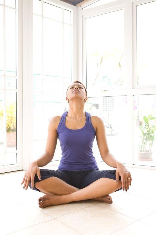 Female doing neck stretching exercise royalty free stock image