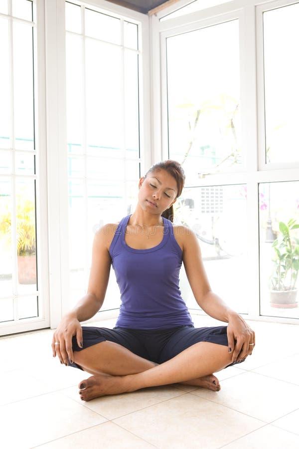 Female doing neck stretching exercise royalty free stock photography