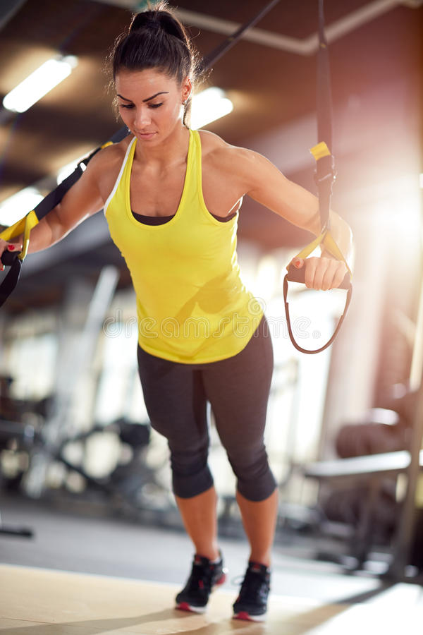 Female doing push ups in gym. Female doing push ups exercise in gym stock photography