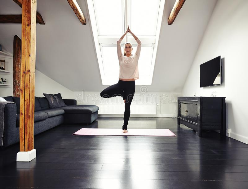 Female doing yoga at home stock photo image 42935888 for Living room yoga timetable