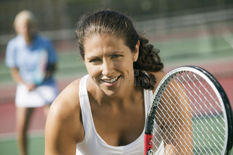 Female doubles tennis players waiting for serve focus on foreground close up stock photo