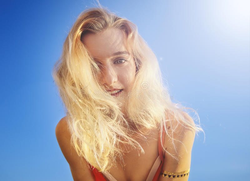Female dressed in coral swimsuit smiling at camera. Day, outdoor . close up stock photos