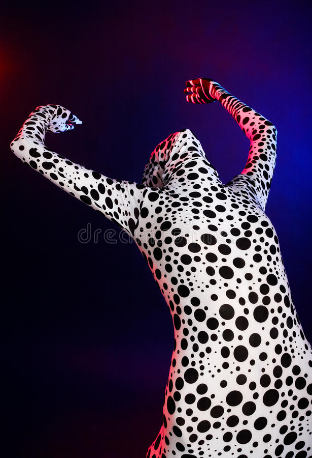 Female dressing in the zentai. On the colour abstract background royalty free stock photo