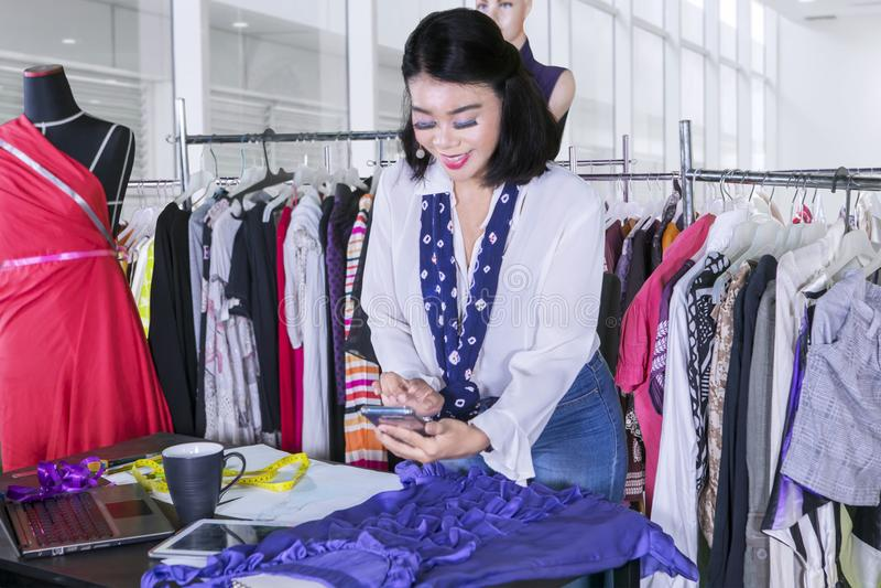Female dressmaker taking photo of her new dress stock images