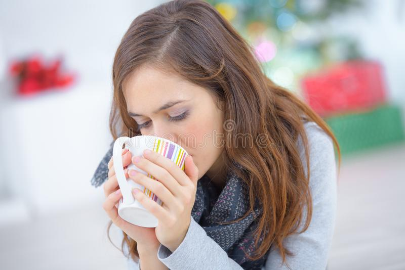 Female drinking cup latte coffee in morning. Female drinking a cup of latte coffee in the morning royalty free stock photos
