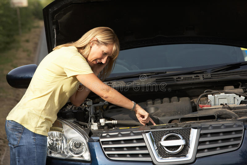 Female Driver Broken Down On Country Road Stock Images