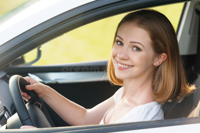 Female driver driving a car royalty free stock image