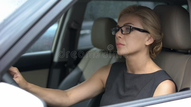Female driver getting stuck in traffic jams, big city life, driving regulations stock photos