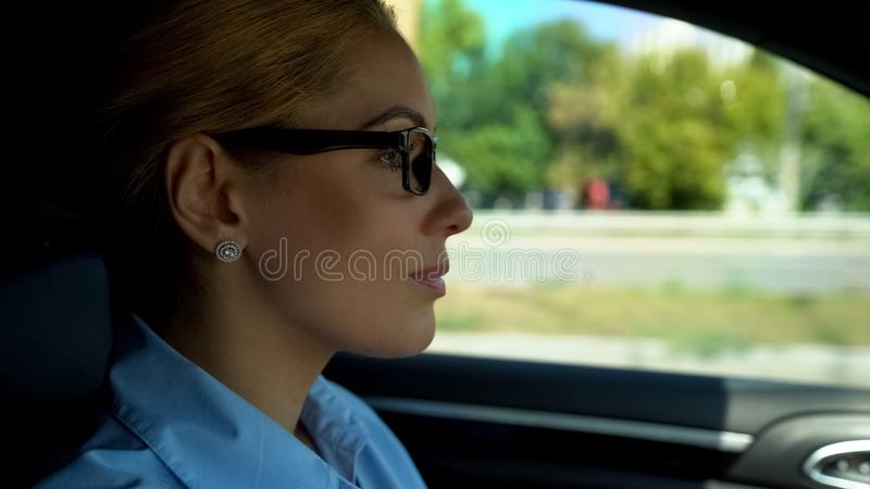 Female driving car for first time, feels insecure, woman keeping to road rules. Stock photo stock photo