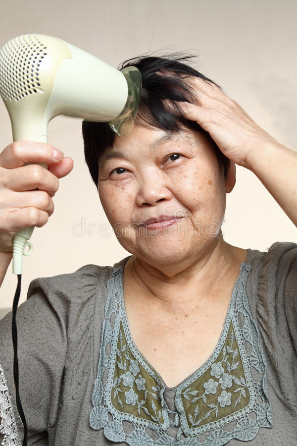 Download Female drying her hairs stock image. Image of blow, embroidery - 20336347