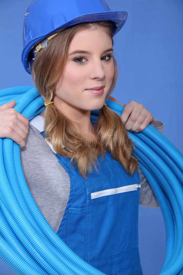 Female electrician with wiring stock image