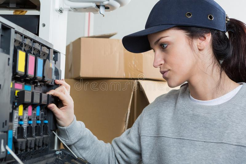Female electrician at work stock image