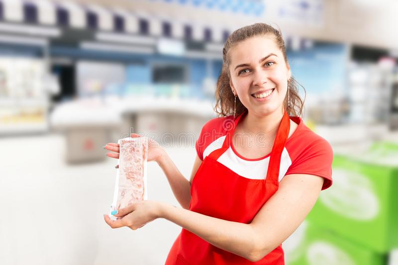 Female employee advertising frozen meat stock photography