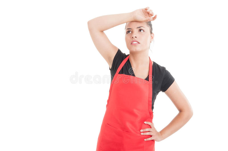 Female employee on hypermarket looking tired. After work on white background with copyspace royalty free stock photography