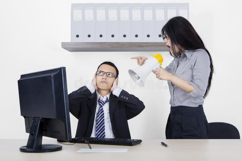 Female employee screaming at her manager stock photo