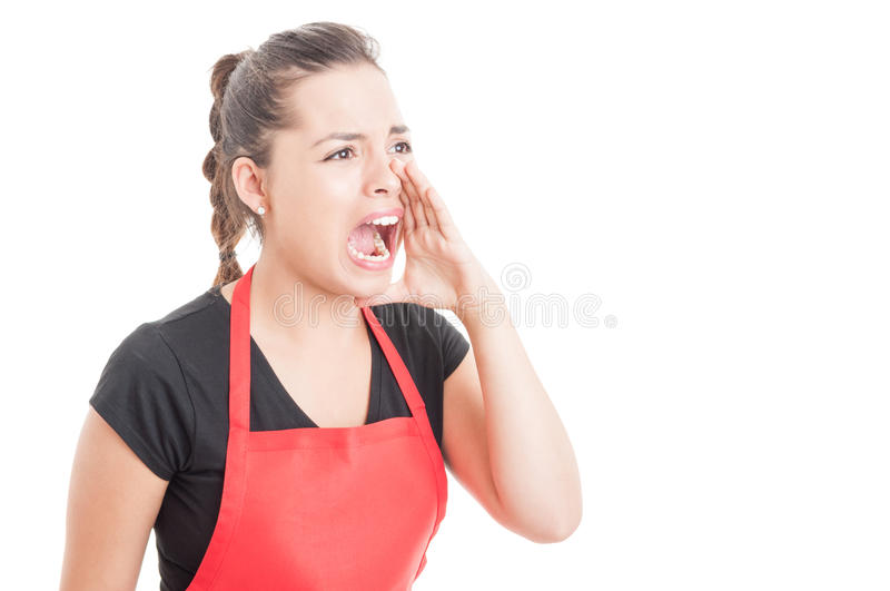 Female employee shouting out loud at somebody. Female employee on supermarket shouting out loud at somebody on white background with copy space stock photos