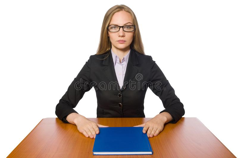 The female employee sitting at long table isolated on white. Female employee sitting at long table isolated on white royalty free stock image