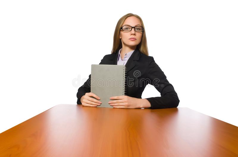 The female employee sitting at long table isolated on white. Female employee sitting at long table isolated on white royalty free stock photos