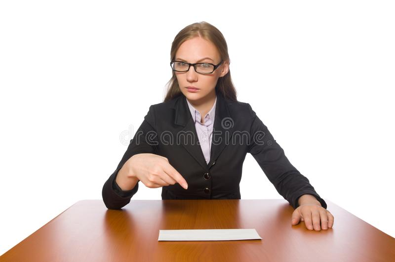 The female employee sitting at long table isolated on white. Female employee sitting at long table isolated on white stock image