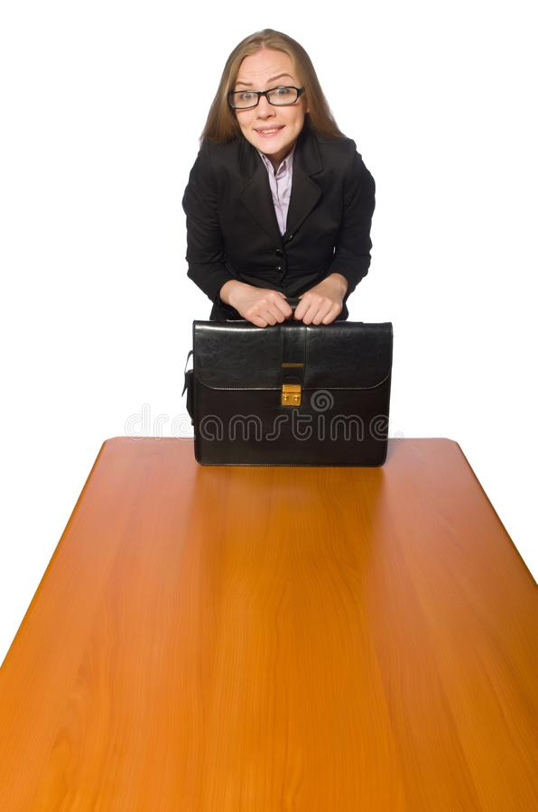 The female employee sitting at long table isolated on white. Female employee sitting at long table isolated on white stock photo