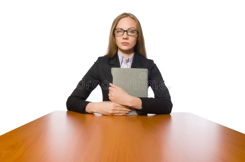 The female employee sitting at long table isolated on white. Female employee sitting at long table isolated on white stock photography