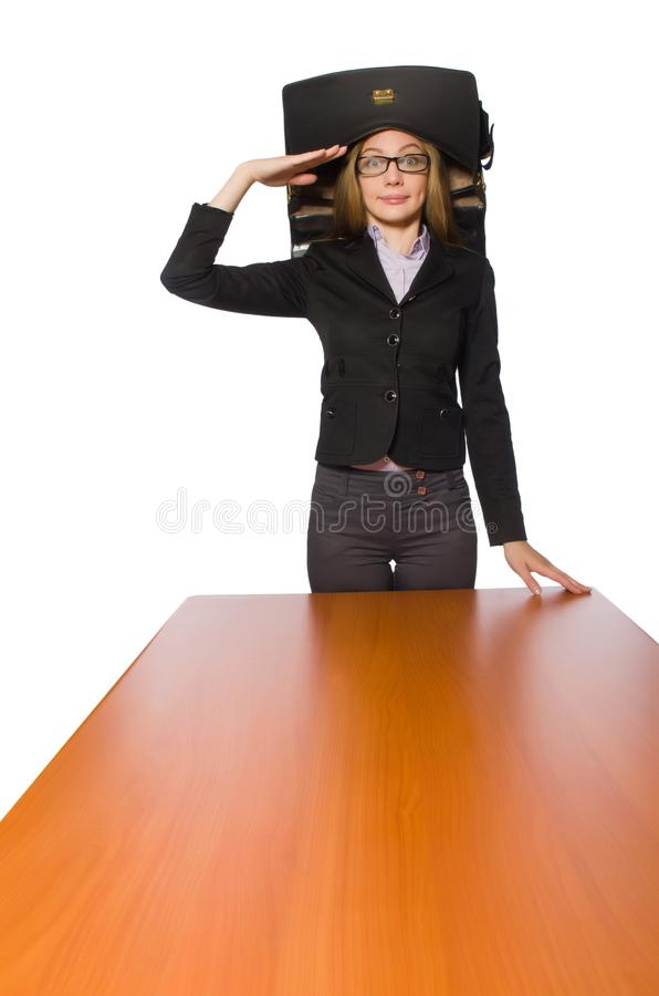 Female employee sitting at long table isolated on white. The female employee sitting at long table isolated on white stock photography