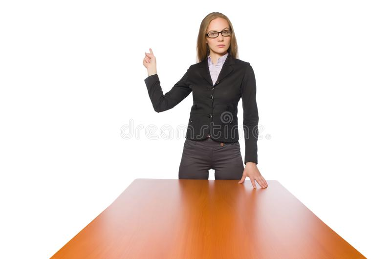 The female employee sitting at long table isolated on white. Female employee sitting at long table isolated on white royalty free stock images