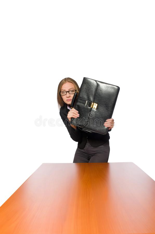 Female employee sitting at long table isolated on white. The female employee sitting at long table isolated on white stock photo