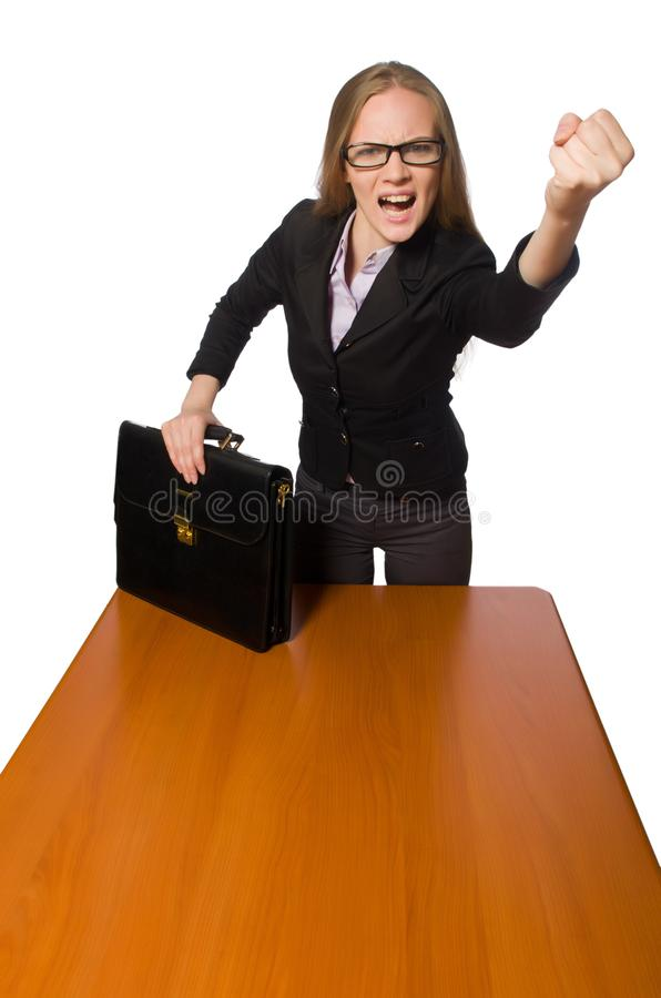 The female employee sitting at long table isolated on white. Female employee sitting at long table isolated on white stock photos