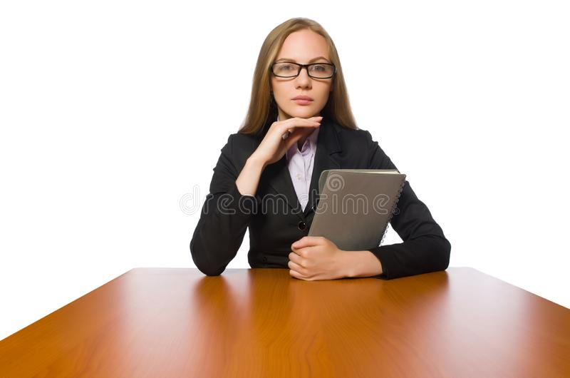 The female employee sitting at long table isolated on white. Female employee sitting at long table isolated on white stock images