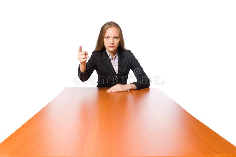 Female employee sitting at long table isolated on white stock photo